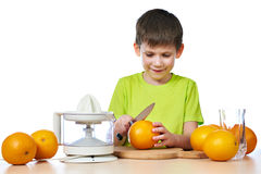 Happy boy cutting orange for juicer  Stock Photo