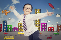 Happy boy dancing with city background Stock Images