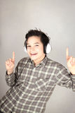 Happy boy dancing. Happy boy listening to music and dancing Royalty Free Stock Images