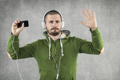Happy boy dancing and listening to music Royalty Free Stock Images