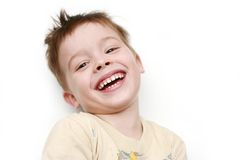 The happy boy is dared laying. On a white background Royalty Free Stock Photo