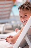 Happy boy on deck chair Royalty Free Stock Image