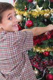 Happy boy decorating the Christmas tree Stock Photography