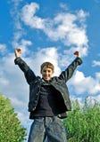 Happy boy in denim jacket. Smiling boy on blue sky Stock Photos