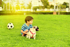 Happy boy with dog. Happy Asian boy playing with his dog in garden Stock Photos