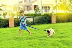 Happy boy with dog Royalty Free Stock Photos