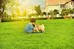 Happy boy with dog Stock Photography