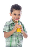 Happy Boy Drinking A Glass of Juice Royalty Free Stock Photography