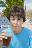 Happy Boy is drinking juice Royalty Free Stock Image