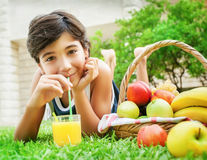 Happy boy drinking juice Stock Photo