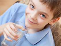 Happy boy drinking water stock images