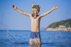 Happy boy driver on the beach Stock Photos