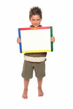 Happy Boy with Dry Erase Board. Adorable seven year old boy holding blank dry erase board royalty free stock images