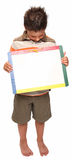 Happy Boy with Dry Erase Board. Adorable seven year old boy holding blank dry erase board stock photography