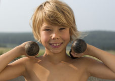 Happy boy with a dumbbell Stock Images