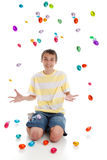 Happy boy with easter eggs falling Stock Photos