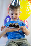 Happy boy eat birthday cake Stock Image