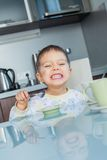 Happy Boy Eating Breakfast Stock Photos