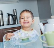 Happy Boy Eating Breakfast Stock Images