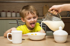 Happy boy  eating breakfast Stock Photo