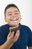 Happy Boy Eating Cookie Royalty Free Stock Image