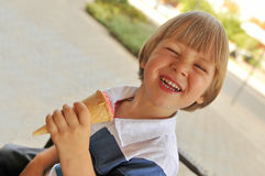 Happy boy eating ice-cream Stock Photos