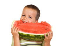 Happy boy eating watermelon Royalty Free Stock Photos