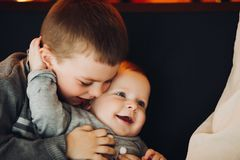Happy boy embracing his little little brother. royalty free stock photos