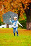 Happy boy enjoying an autumn rain in park Royalty Free Stock Images