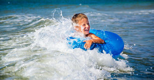 Happy boy enjoying swimming in sea with rubber Royalty Free Stock Photo