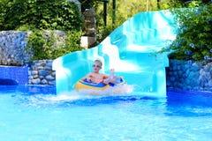 Happy boy enjoying waterslide Royalty Free Stock Image