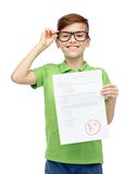 Happy boy in eyeglasses holding school test result Stock Photography