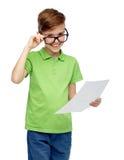 Happy boy in eyeglasses holding school test result Stock Image