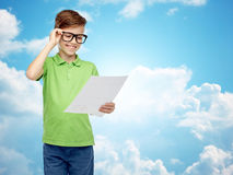 Happy boy in eyeglasses holding school test result Royalty Free Stock Photography