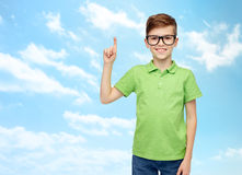 Happy boy in eyeglasses pointing finger up Royalty Free Stock Photography