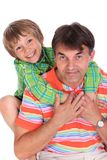 Happy boy with father. Half body portrait of happy boy on middle aged fathers back, isolated on white background Royalty Free Stock Photography