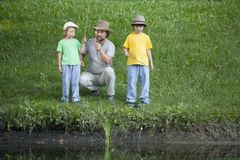 Happy boy and father go fishing on the river, children with a fi Royalty Free Stock Images