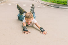 Happy boy faving fun on roller scates on natural backgroun Stock Photography