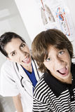Happy boy and female medical doctor Stock Images