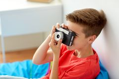 Happy boy with film camera photographing at home Stock Image