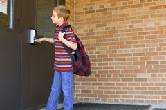 Happy boy on the first day of school royalty free stock photography