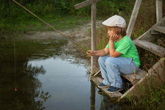 Happy boy fishing on river Royalty Free Stock Photo