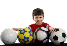 Happy boy with the four soccer balls Royalty Free Stock Image