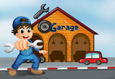 A happy boy in front of a garage Stock Image