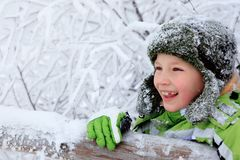 Happy boy in frozen forest Stock Photos