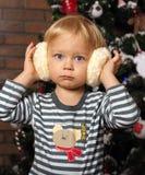 Happy boy with fur headphones Stock Photo