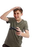 Happy boy with game controller. Happy boy at leisure, holding a wireless game controller.  White background Royalty Free Stock Image