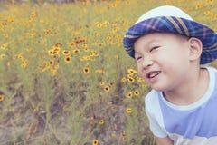 Happy boy in garden Stock Photos