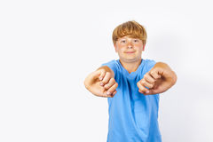 Happy boy gestures with his arms Stock Photo