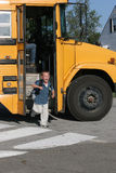 Happy Boy Getting Off The School Bus Stock Images